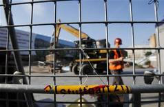 An excavator works in front of the Stuttgart train station, June 15, 2011. German rail operator Deutsche Bahn restarted work on the controversial Stuttgart 21 rail project on Tuesday. The project involves rebuilding the city's historical main station to make way for the Stuttgart 21 underground railway station. REUTERS/Alex Domanski (GERMANY - Tags: POLITICS TRANSPORT)