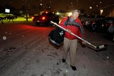 Paul Koukal, a retired dentist, arrives at the rink for a game with his Niagara Falls Senior Alumni Hockey League's Leafs, in Niagara Falls, New York January 17, 2013. REUTERS/Doug Benz