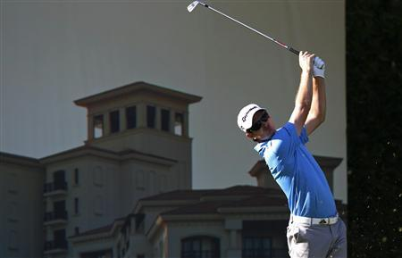 Justin Rose of England tees off at the 12th hole during the third round of the Abu Dhabi Golf Championship at the Abu Dhabi Golf Club January 19, 2013. REUTERS/Ahmed Jadallah