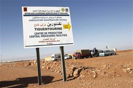 A road sign indicating the Tiguentourine gas plant is seen near the mobile hospital tent for first aid, about 130 km from the Algerian and Libyan border, where Islamist militants have been holding foreigners hostage, January 19, 2013. More than 20 foreigners were captive or missing inside a desert gas plant on Saturday, nearly two days after the Algerian army launched an assault to free them that saw many hostages killed. The standoff between the army and al Qaeda-linked gunmen - one of the biggest international hostage crises in decades - entered its fourth day, having thrust Saharan militancy to the top of the global agenda. REUTERS/Louafi Larbi (ALGERIA - Tags: CIVIL UNREST POLITICS ENERGY)