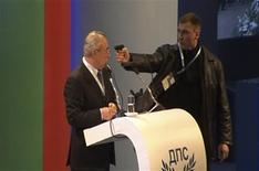 An unidentified man (R) attacks Ahmed Dogan, leader of Bulgaria's Movement for Rights and Freedom (MRF) party, as he delivers his speech during his party's annual conference at the National Palace of Culture in Sofia in this still image taken from video footage on January 19, 2013. REUTERS/Nikola Stoyanov/Bnews