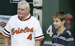"Former Baltimore Orioles manager and member of Major League Baseball's Hall of Fame, Earl Weaver stands with his grand son Jake in the dugout along side a plaque and Weaver's number ""4"" before the Orioles MLB interleague baseball game against the Pittsburgh Pirates in Baltimore, Maryland in this June 13, 2008, file photo. Hall-of-fame manager Earl Weaver passed away in the early morning hours of January 19, 2013, after suffering an apparent heart attack. He was 82. REUTERS/Joe Giza/Files"