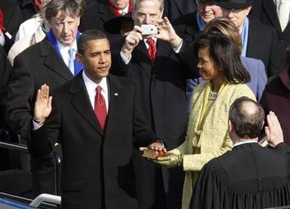 Barack Obama takes the Oath of Office as the 44th president of the United States from U.S. Chief Justice John Roberts as his wife Michelle holds the Bible during the inauguration ceremony in Washington, in this January 20, 2009 file photo. REUTERS/Jim Bourg/Files