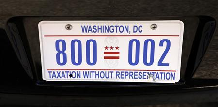 The motorcade vehicle of U.S. President Barack Obama bears the license plate ''Taxation Without Representation'' in Washington January 19, 2013. REUTERS/Kevin Lamarque