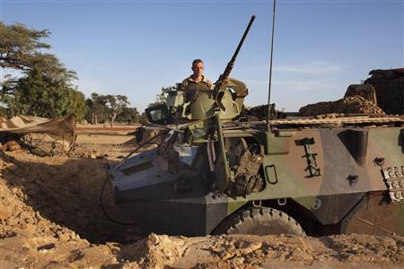 A French soldier sits atop an armoured vehicle outside Markala, January 19, 2013. Islamist rebels in Mali abandoned the central town of Diabaly on Friday after fleeing a French air strike, military sources said, while West African troops arrived in Bamako to take on the insurgents in Mali's north. REUTERS/Joe Penney