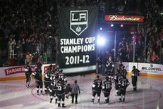 Los Angeles Kings players watch as their Stanley Cup championship banner is raised at the Staples Center before their NHL hockey game against the Chicago Blackhawks in Los Angeles, California, January 19, 2013. REUTERS/Lucy Nicholson