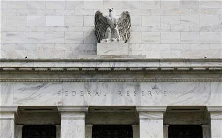 A view shows an eagle sculpture on Federal Reserve building in Washington August 22, 2012. REUTERS/Larry Downing/fILES