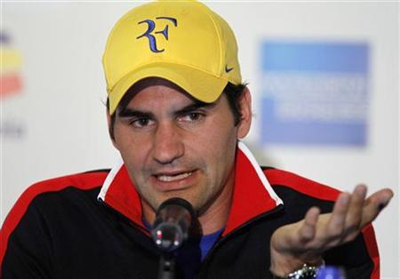 Tennis player Roger Federer of Switzerland speaks at a news conference ahead of an exhibition match in Bogota December 14, 2012. REUTERS/John Vizcaino/Files