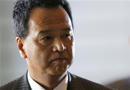 Japan's newly-appointed minister for economic revival Akira Amari arrives at Prime Minister Shinzo Abe's official residence in Tokyo December 26, 2012. REUTERS/Kim Kyung-Hoon