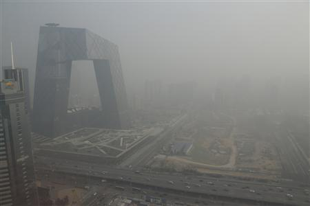 The China Central Television (CCTV) building is seen next to a construction site in heavy haze in Beijing's central business district in this January 14, 2013 file photo. REUTERS/Jason Lee/Files