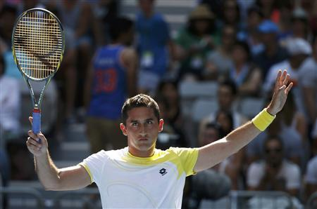 Almagro through to quarter-final after Tipsarevic retires
