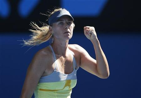 Maria Sharapova of Russia celebrates defeating Kirsten Flipkens of Belgium in their women's singles match at the Australian Open tennis tournament in Melbourne January 20, 2013. REUTERS/Damir Sagolj