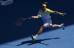 L'Espagnol David Ferrer, tête de série n°4, s'est qualifié dimanche pour les quarts de finale de l'Open d'Australie en écartant facilement le Japonais Kei Nishikori 6-2 6-1 6-4. /Photo prise le 20 janvier 2013/REUTERS/Damir Sagolj