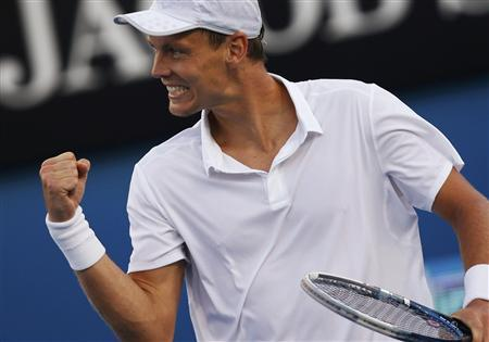 Tomas Berdych of Czech Republic celebrates defeating Kevin Anderson of South Africa in their men's singles match at the Australian Open tennis tournament in Melbourne January 20, 2013. REUTERS/Damir Sagolj