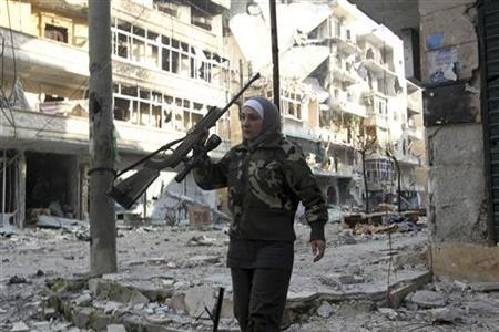 Guevara, a Syrian Palestinian woman married to an Al Wa'ad battalion commander, is pictured in Aleppo January 19, 2013. REUTERS/ Muzaffar Salman