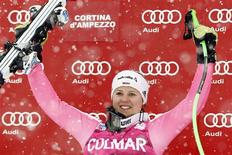 Viktoria Rebensburg of Germany celebrates on the podium after winning the women's Super G event at the Alpine Skiing World Cup in Cortina d'Ampezzo January 20, 2013. REUTERS/Giampiero Sposito
