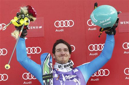 Winner Felix Neureuther of Germany reacts on podium after the second run of the men's Alpine Skiing World Cup slalom race in Wengen January 20, 2013. REUTERS/Ruben Sprich