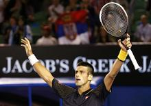 Novak Djokovic of Serbia celebrates defeating Stanislas Wawrinka of Switzerland during their men's singles match at the Australian Open tennis tournament in Melbourne January 21, 2013. REUTERS/Daniel Munoz