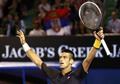 Djokovic survives scare from Wawrinka to advance