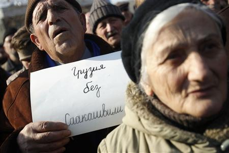 People attend a rally to demand the resignation of Georgia's President Mikheil Saakashvili near the Presidential Palace in Tbilisi January 20, 2013. The placard reads in Russian, ''Georgia without Saakashvili''. REUTERS/David Mdzinarishvili