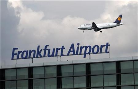 An aircraft of German air carrier Lufthansa flies beyond the newly built A-Plus terminal section during a guided tour for the media at the Fraport airport in Frankfurt September 28, 2012. REUTERS/Lisi Niesner