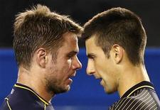 Novak Djokovic of Serbia (R) shakes hands with Stanislas Wawrinka of Switzerland after defeating him in their men's singles match at the Australian Open tennis tournament in Melbourne January 21, 2013. REUTERS/Daniel Munoz