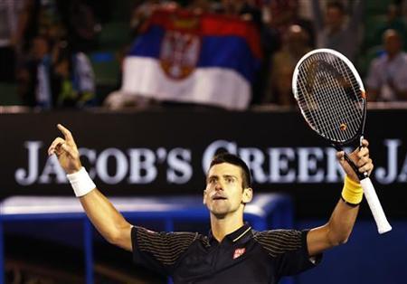 Novak Djokovic of Serbia celebrates his victory in his men's singles match against Stanislas Wawrinka of Switzerland at the Australian Open tennis tournament in Melbourne January 21, 2013. REUTERS/Daniel Munoz