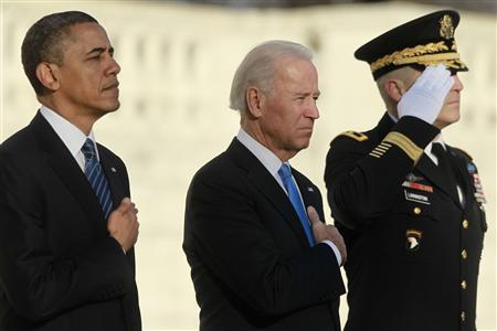 U.S. President Barack Obama and Vice President Joe Biden (C) listen to taps being played after laying a wreath at the Tomb of the Unknown Soldier at Arlington National Cemetery near Washington, January 20, 2013. REUTERS/Jason Reed
