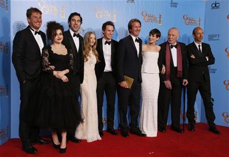 The Cast of ''Les Miserables'' (From L) producer Tim Bevan, Helena Bonham Carter, Sasha Baron Cohen, Amanda Seyfried, Eddie Redmayne, director Tom hooper, Anne Hathaway, unidentified and producer Eric Fellner, celebrate their win for Best Motion Picture, Comedy or Musical backstage at the 70th annual Golden Globe Awards in Beverly Hills, California, January 13, 2013. REUTERS/Lucy Nicholson