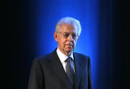Outgoing Prime Minister Mario Monti arrives for the presentation of '' La Democrazia in Europa'' the book he wrote with Euro-MP Sylvie Goulard in Rome, January 9, 2013. REUTERS/Stefano Rellandini