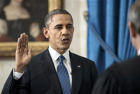 U.S. President Barack Obama takes the official oath of office from U.S. Supreme Court Chief Justice John Roberts, as Obama is sworn in for his second term as the 44th President of the United States, at the White House in Washington January 20, 2013. REUTERS/Brendan Smialowski/Pool