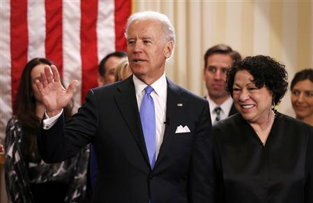 U.S. Vice President Joe Biden (L) after taking the oath of office from Supreme Court Justice Sonia Sotomayor (R) at the U.S. Naval Observatory in Washington January 20, 2013. REUTERS/Kevin Lamarque