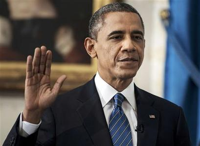 U.S. President Barack Obama is sworn in for a second term as President of the United States in the Blue Room of the White House in Washington, DC January 20, 2013. REUTERS/Brendan Smialowski/Pool