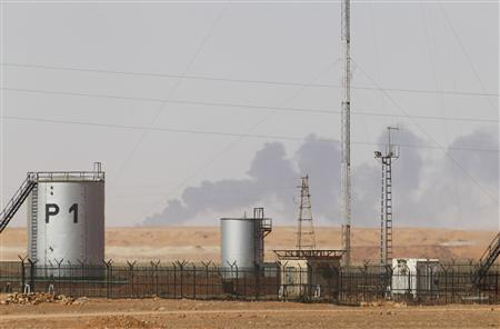 Smoke rises above following demining operations at the In Amenas gas plant January 20, 2013. Algeria said on Sunday it expected heavy hostage casualties after its troops ended a desert siege, but Western governments warned against criticising tactics used by their vital ally in the struggle with Islamists across the Sahara. REUTERS/Louafi Larbi