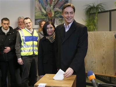Lower Saxony federal state premier David McAllister of the Christian Democratic Union party (CDU) and his wife Dunja (centre L) cast their votes in the Lower Saxony state election at a polling station in the northern German town of Bad Bederkesa January 20, 2013. REUTERS/Morris Mac Matzen