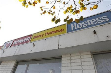 Signage is pictured at a Hostess Bakery Thriftshop that remains open selling baked goods in Glendale, California November 26, 2012. REUTERS/Fred Prouser
