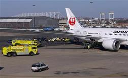 Fire trucks surround a Japan Airlines Boeing 787 Dreamliner that caught fire at Logan International Airport in Boston, Massachusetts January 7, 2013. REUTERS/Brian Snyder