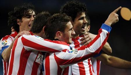 Atletico's Madrid Jorge Resurreccion ''Koke'' (C) is congratulated by his teammates after scoring a goal against Levante during their Spanish first division soccer match at Vicente Calderon stadium in Madrid January 20, 2013. REUTERS/Sergio Perez