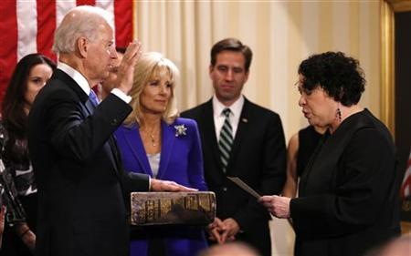 U.S. Vice President Joe Biden (L) takes the oath of office from Supreme Court Justice Sonia Sotomayor as his wife Jill Biden holds the family bible while family members look on at the U.S. Naval Observatory in Washington January 20, 2013. REUTERS/Kevin Lamarque