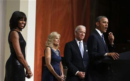 U.S. President Barack Obama (R), first lady Michelle Obama (L), Vice President Joseph Biden (2nd R) and his wife, Jill Biden (2nd L), attend an inaugural reception at the National Building Museum in Washington January 20, 2013. REUTERS/Larry Downing