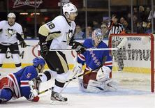 New York Rangers goaltender Martin Biron (R) reacts after Pittsburgh Penguins winger James Neal (18) scored during the third period of their NHL hockey game at Madison Square Garden in New York January 20, 2013. REUTERS/Bill Kostroun