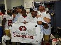 Members of the San Francisco 49ers pose in locker room with NFC championship banner after they defeated the Atlanta Falcons in the NFL NFC Championship football game in Atlanta, Georgia January 20, 2013. REUTERS/Jeff Haynes