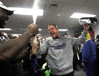 Baltimore Ravens head coach John Harbaugh celebrates in the dressing room after his team defeated the New England Patriots in the NFL AFC Championship football game in Foxborough, Massachusetts, January 20, 2013. REUTERS/Jim Young