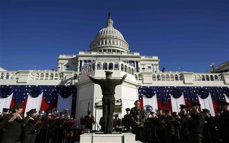 A military band conductor rehearses the Stars and Stripes on the eve of ceremonies marking the second inauguration of U.S. President Barack Obama at the U.S. Capitol in Washington, January 20, 2013. REUTERS/Jason Reed
