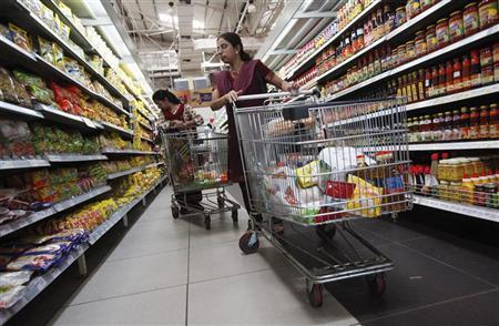 Women shop for instant noodles at a retail supermarket in Mumbai March 16, 2012. REUTERS/Vivek Prakash/Files