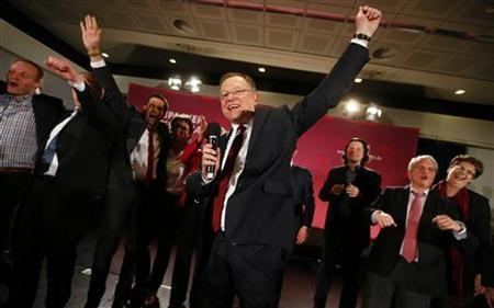 Stephan Weil (C), top candidate of the Social Democratic Party (SPD), celebrates with party fellows after an official preliminary election result showed him as the winner of the state elections for Lower Saxony in Hanover January 20, 2013. REUTERS/ Kai Pfaffenbach
