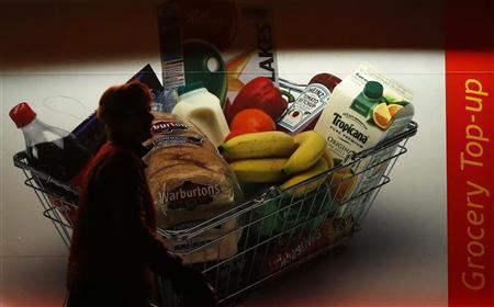 A woman walks past a grocery store in Loughborough, central England, January 10, 2013. REUTERS/Darren Staples (