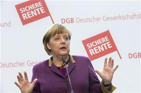 German Chancellor Angela Merkel briefs the media after visiting a board meeting of Germany's labour union association DGB in Berlin, January 15, 2013. REUTERS/Thomas Peter