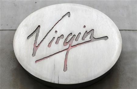 A logo is seen next to the entrance of the Virgin Megastore at the Champs Elysees in Paris, January 4, 2013. REUTERS/Christian Hartmann