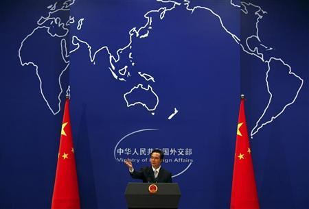 China's Foreign Ministry spokesman Hong Lei asks journalists for questions during a news conference in Beijing July 7, 2011. REUTERS/David Gray